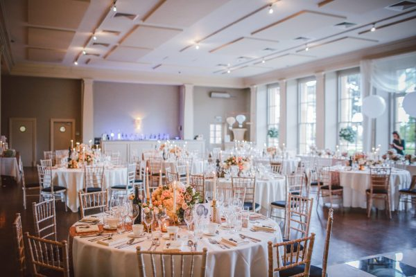 hotel ballroom with chivaris and elegant table settings