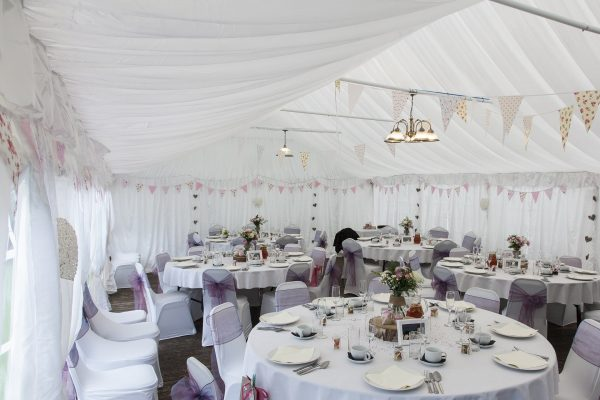 super white draped tent with purple